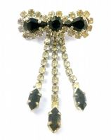 Vintage Black And Clear Rhinestone Bow Dropper Brooch.
